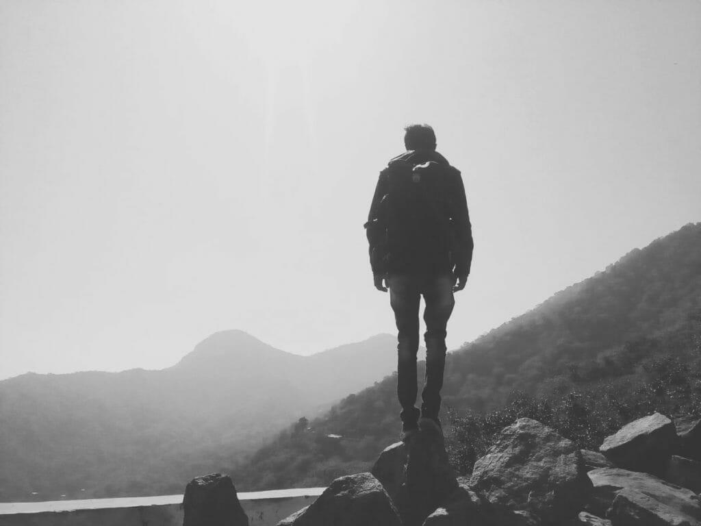 Man on hike overcoming opiate abuse
