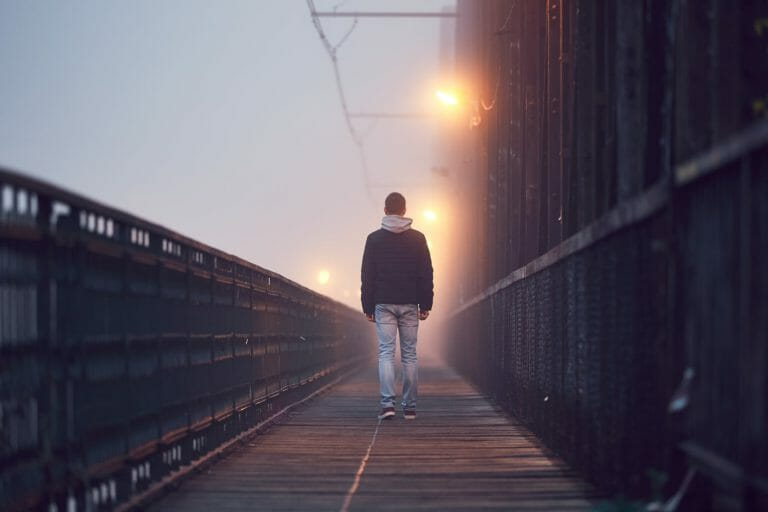Someone walking alone with adjustment disorder