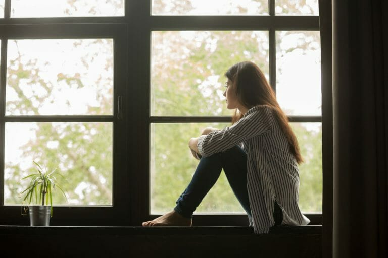 A addict with bipolar disorder looking out window