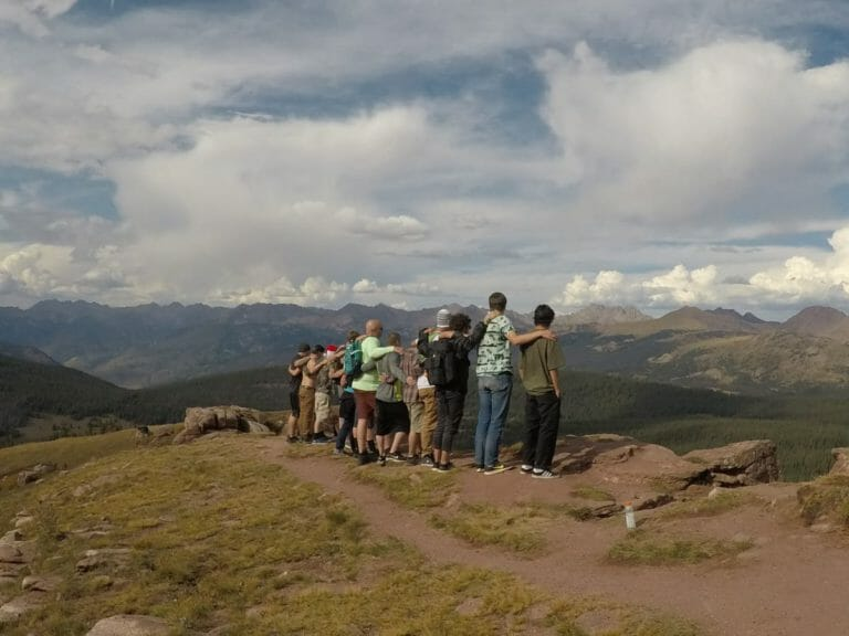 Group of men on holistic hike together in rehab